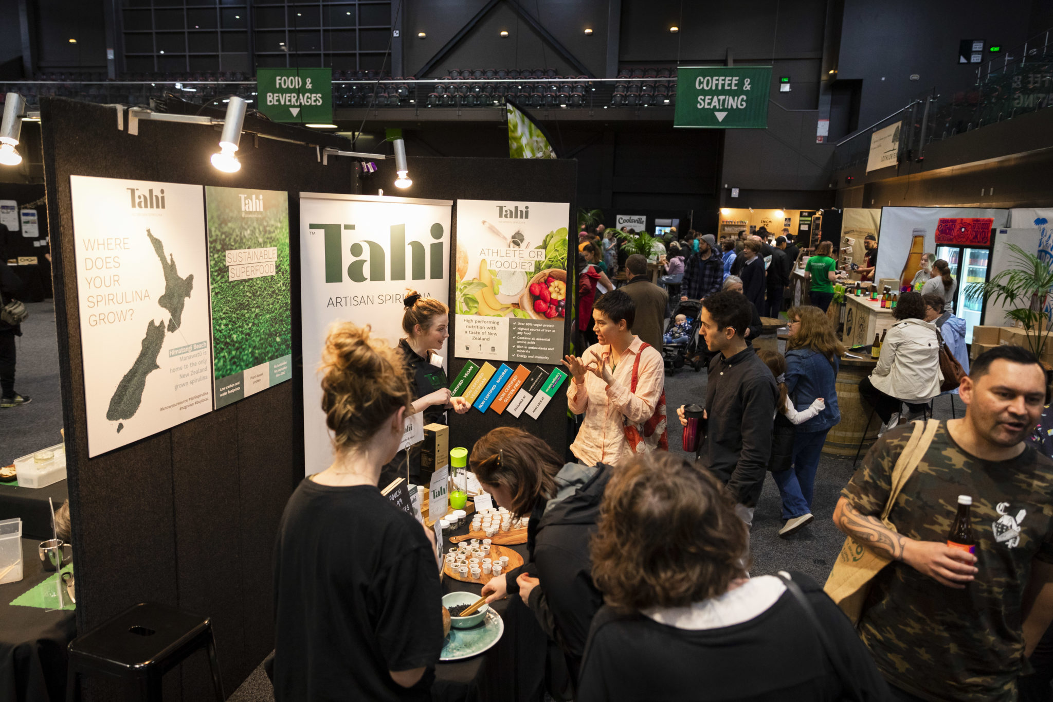 People tasting spirulina at expo