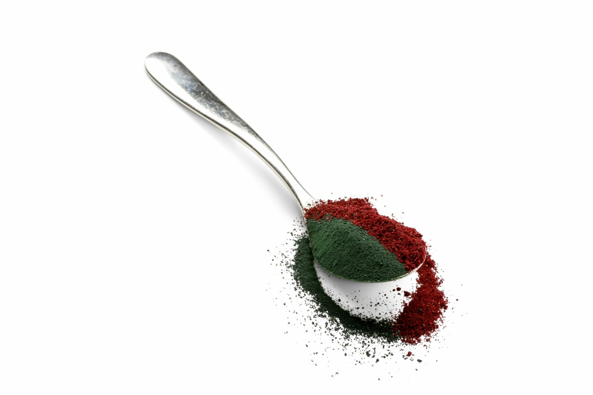 Spirulina with blackcurrant powder on spoon